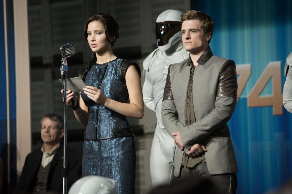 Katniss und Peeta vor der Kamera - auch im Film.